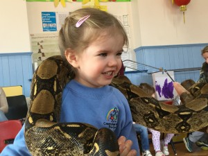 Three year old Bea and Kaa the Boa Constrictor